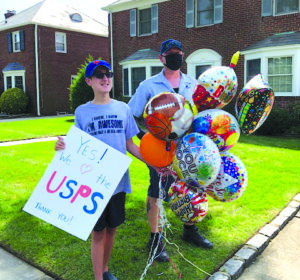 Matthew McCoy with Phil the letter carrier, celebrating his birthday.