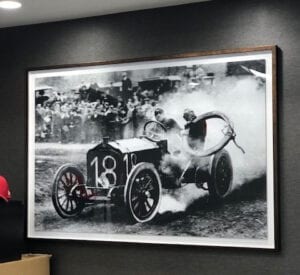 Historic photos, such as this one from the Vanderbilt Cup Races, adorn the hotel's wall.