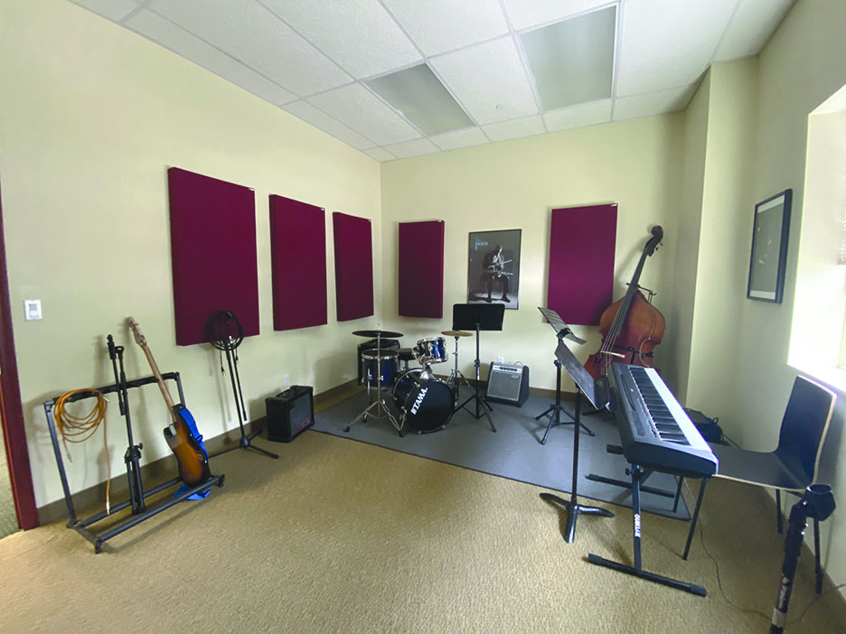 room with musical instruments and chairs