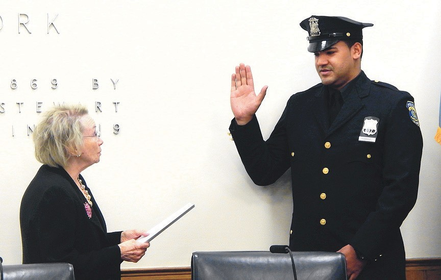 deputy mayor theresa trouv administers the oath of office to officer eduardo rodriguez during the thursday - Garden City Police Department