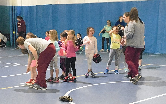 Garden City High School players work with youth participants
