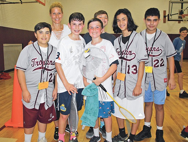 badminton champions kevin roberti and david debusschere are pictured with their team of supporters and teacher - Garden City Middle School